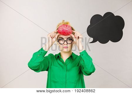 Business Woman Intensive Thinking Holding Brain