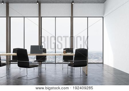 Front view of a meeting room interior with white walls concrete floor panoramic windows and a long table with laptops with black office chairs around it. Fireplace. 3d rendering mock up