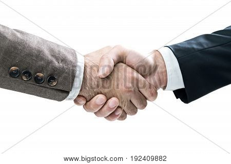 Isolated close up portrait of two businessmen shaking hands. They are wearing good suits and are eager to collaborate. Concept of business relations.