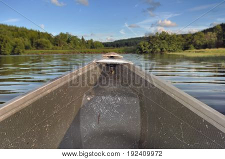 prow of a canoe navigate on a lake
