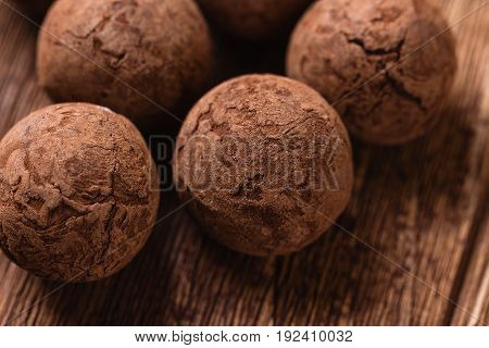 Chocolate Truffles On Wooden Background