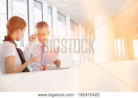 Business coworkers discussing work in office