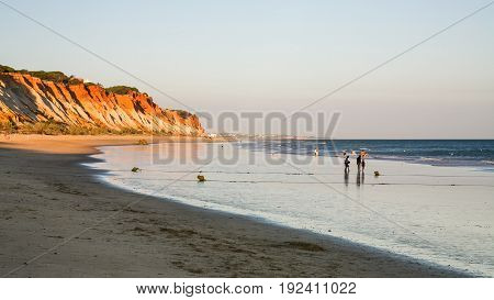 People Walk On Beach Praia Falesia Near Albufeira