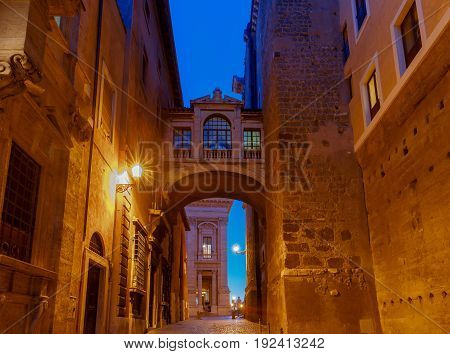 Medieval street in front of City Hall at night. Rome. Italy.