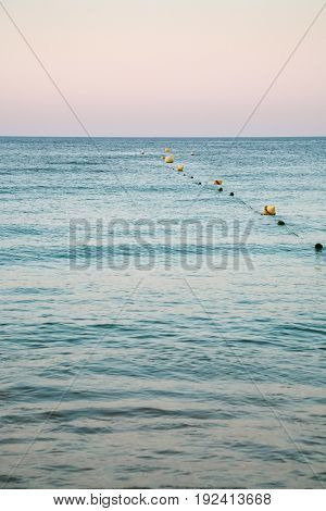 Buoys In Water On Beach Near Albufeira