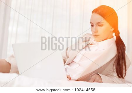 Businesswoman using laptop in hotel room