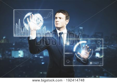 Businessman pressing abstract glowing business screen projections on nigth city background. Future concept