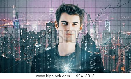 Portrait of handsome young businessman on illuminated night city background with business charts. Finance concept. Double exposure