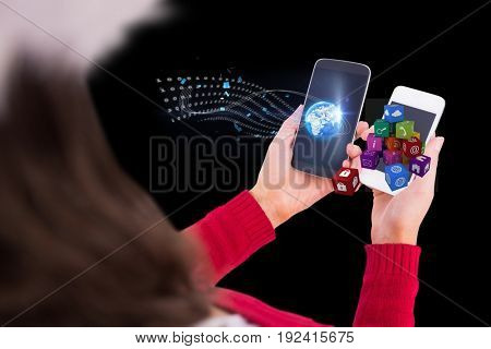 Digital composite of girl holding two phones with graphics