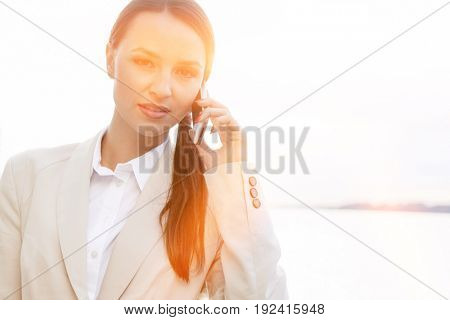 Portrait of confident businesswoman using cell phone outdoors