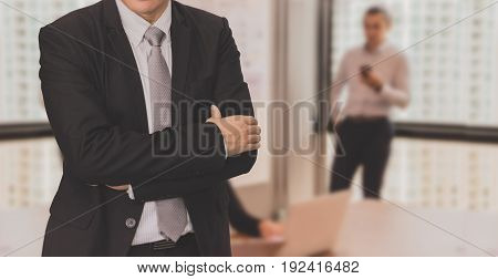 Youngs is working in office building background