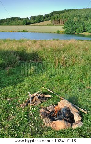 campfire on a shore of a lake