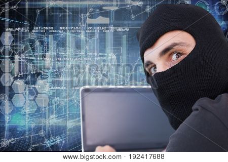 Digital composite of Hacker using his computer with cover face