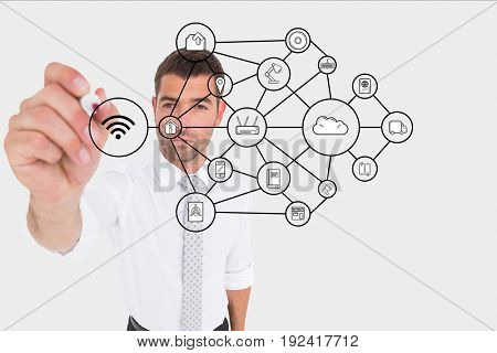 Digital composite of Businessman drawing a graph on the screen