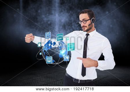 Digital composite of Business man presenting icons and wearing Headset