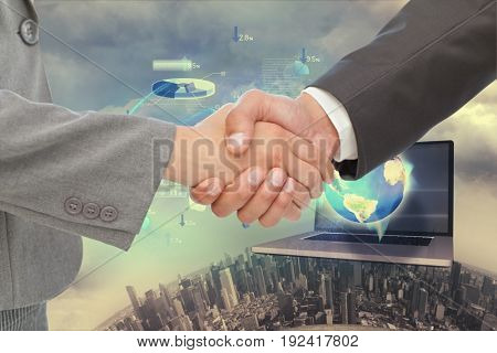 Digital composite of Business man Handshake against technology background