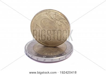 euro end ruble coins isolated on white background