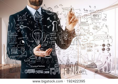 Bearded businessman drawing abstract business sketch in interior with city view and sunlight. Product placement concept. 3D Rendering
