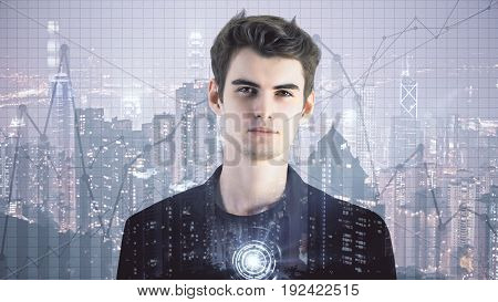 Portrait of handsome young businessman on illuminated night city background with business charts. Accounting concept. Double exposure