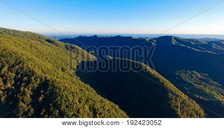 mountain landscape in the West of Abkhazia with a view of the sea and high mountains covered with green forests