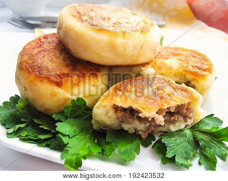 Homemade potato cakes with beef and pork meat filling, selective focus