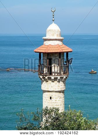 The upper part of the minaret of Al-Bahr Mosque in old city Jaffa Israel