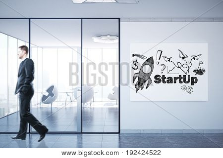 Side view of walking businessman in concrete interior with rocket sketch on poster. Startup concept. 3D Rendering