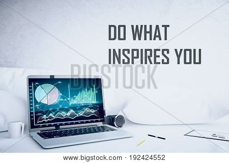 Laptop with business charts at hipster workplace. Do what inspired you concept. 3D Rendering