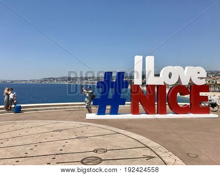 NICE - JUNE 20, 2017: An #ilovenice sign in the French national colours to promote the holiday destination on social media in Nice, Côte d'Azur, France.