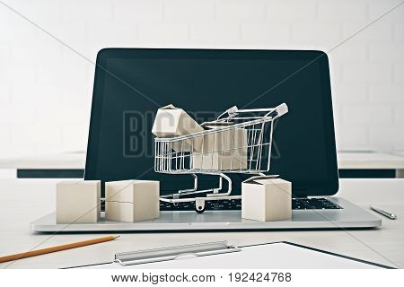Front view of empty laptop screen with shopping cart and boxes. Digital business concept. Mock up 3D Rendering