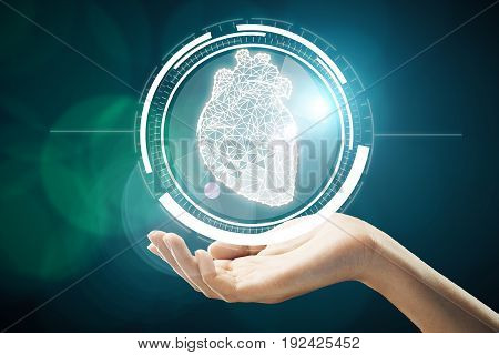 Hand holding abstract digital circle with polygonal heart inside. Medical technologies concept. 3D Rendering