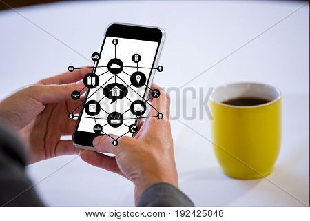 Digital composite of IOT graphics hand with devices