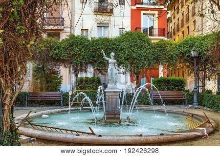 Small garden with fountain on Plaza de Joan de Vila-rasa in Valencia Spain