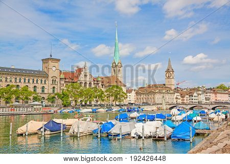 Panorama of historical part of Zurich with famous Fraumunster and St. Peter church on a beautiful summer day Switzerland.