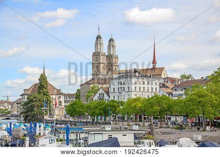 Zurich Switzerland - June 10 2017: Minster Grossmunster view from Quaibrucke bridge river Limmat in front.