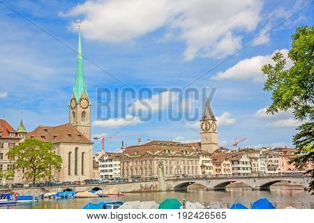 Fraumunster and St. Peter church - view from Limmatquai in downtown Zurich Switzerland on a beautiful summer day.