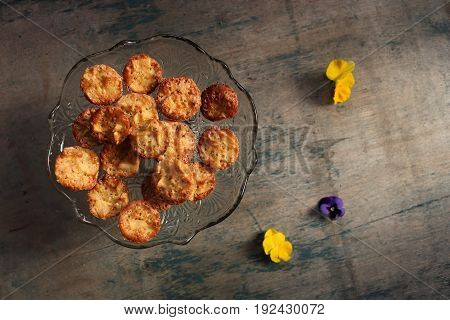 Muffins on a dark wooden background with flowers. Homemade baking. Mini apple charlottes.