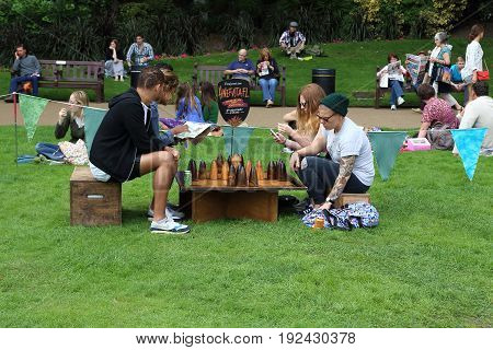 LONDON, GREAT BRITAIN - SEPTEMBER 7, 2014: These are unidentified young people who understand the ancient game at Thames Festival in Victoria Embankment Gardens.