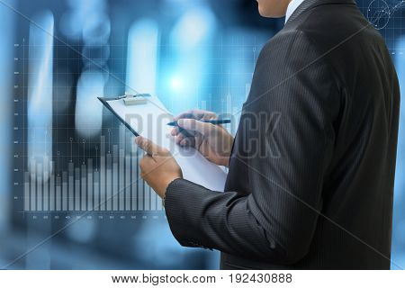 Businessman Working With Graph .