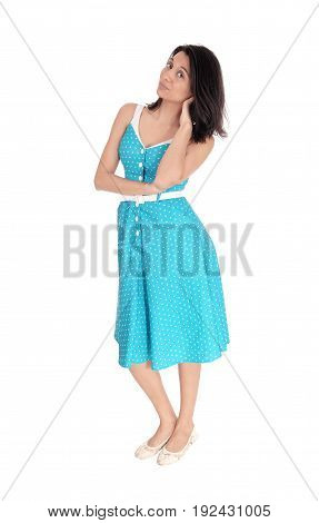 A smiling gorgeous young woman standing in full length in a blue dress isolated for white background.