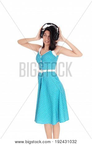 A image of a beautiful woman listening with her headphone to music with her eyes closed isolated for white background.