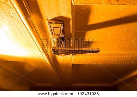 Old pen on the door in golden light .