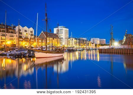 GDANSK, POLAND - JUNE 21, 2017: Marina at Motlawa river in Gdansk at night, Poland. Gdansk is the historical capital of Polish Pomerania.