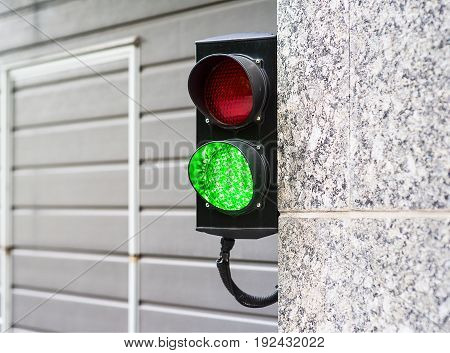 Green and Red Stop Light in garage enter new modern
