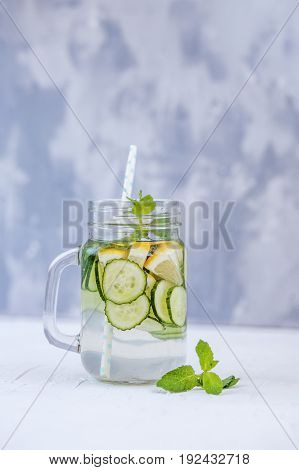 Detox water with cucumber lemon and mint. The concept of a diet a vegetarian healthy food and a lifestyle.