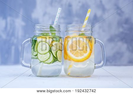 Delicious detox water with cucumber lemon and mint. Lemonade with orange. The concept of a diet a vegetarian healthy food and a lifestyle.