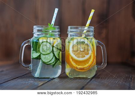 Detox water with cucumber lemon and mint. Lemonade with orange. The concept of a diet a vegetarian healthy food and a lifestyle.