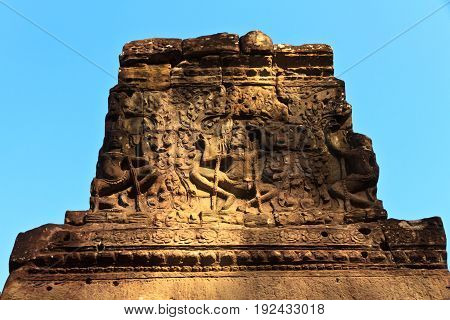 Ancient stone wall stucco sculpture on the antique carving wall at ancient temple like Bayon temple in Cambodia