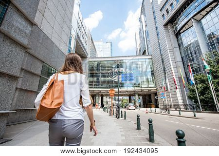 BRUSSEL, BELGIUM - June 01, 2017: Woman walking near the parliament building of European Union in Brussel city