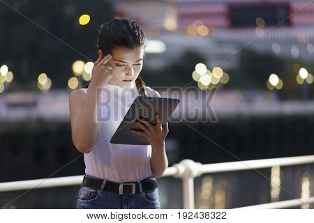 Girl Using A Tablet Pc, Outdoors.